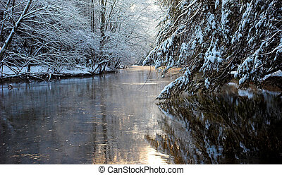 River in early morning with mist rising after snow storm