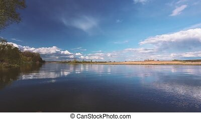 River Or Lake Landscape With Reflections Of Cloudy Sky In...