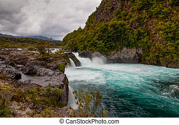 River Petrohue with volcanic rock formations in cloudy weather, Chile.