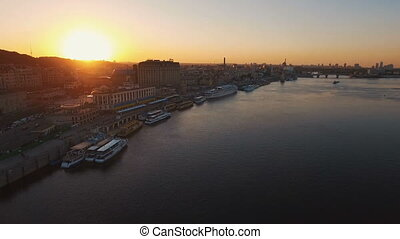 River port with boats in the old part of town at sunset aerial
