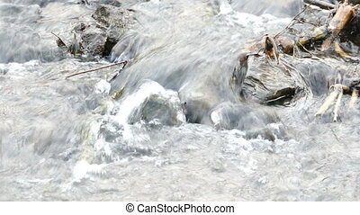 River rapid with rocks, closeup view - Fast river stream...