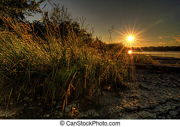 A beautiful warm summer sunset at Weir's Rapids on the Maumee river in northwest Ohio.
