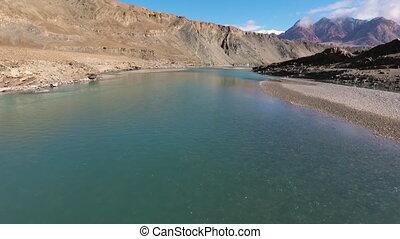 River Running Through Mountain - Drone, exterior, pushing...