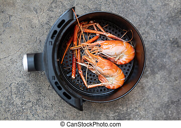 River shrimp cooked in black air fryer. Easy cooking in house concept