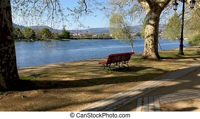River side view in Ponte de Lima - Park bench in river side...