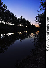 River Silhouettes at Sunset