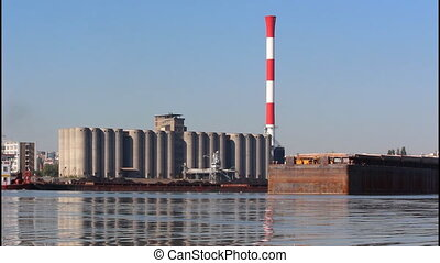River, silos - Water, silos, red chimney