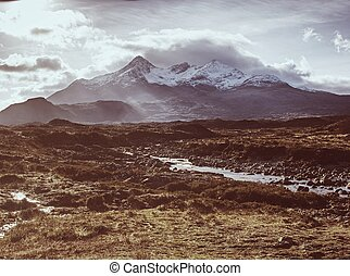 River Sligachan and the mountains of Sgurr nan Gillean on a cloudy day at Isle of Skye - Scotland, UK