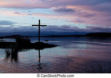 River Stillness Cross - Still morning water in this image of...