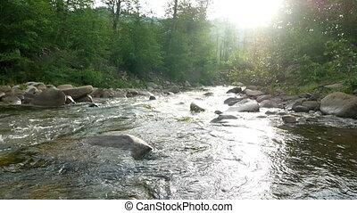 River stone mountain sun - Mountain river stone stream in...