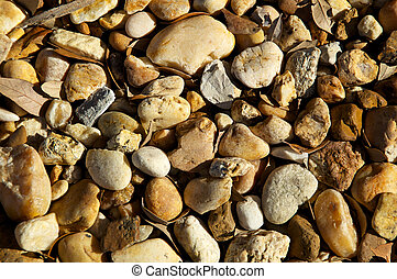 river stones with leaves background
