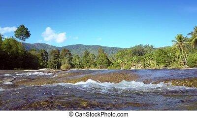 river streams flow fast against pictorial landscape -...