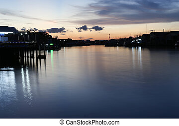 River to the Sea in Fisherman village with silhouette Sunset