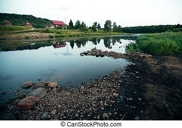 River view in a remote Russian Northern village, early in the morning at dawn.