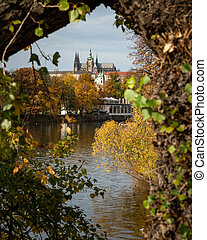 River Vltava and castle of Prague on a sunny day in autumn