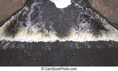 river water splash in concrete dam