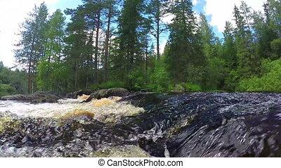 River waterfall slow motion in Karelia, Russia