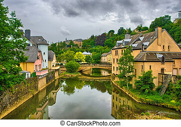River with houses and bridges in Luxembourg, Benelux, HDR -...