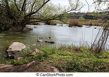 River with large granite stones. Steppe. Nature