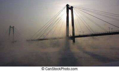River,bridge, mist, sun.