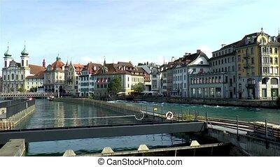 Riverfront buildings in Luzern, Lucerne, Switzerland. Jesuit Church.