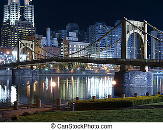 Riverfront park with graceful bridge in Pittsburgh Pennsylvania.
