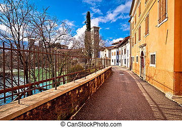 Riverfront walkway in Cividale del Friuli, Natisone river,...