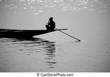 Riverscene on the Niger - Romantic sunset atmosphere at...
