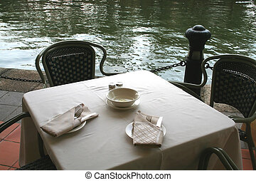 Riverside cafe, table and chairs