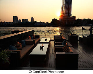 riverside resturant at sunset in Bangkok