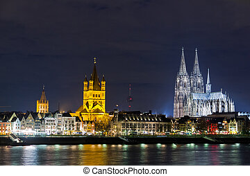 Cologne - Riverside view of the Town Hall, church of Great...