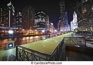 Riverwalk Downtown Chicago, Illinois USA. Super Wide Angle NIght Time Photography of Chicago River, Riverwalk and Skyscrapers.