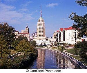View along the Riverwalk towards skyscrapers, San Antonio, Texas, USA.