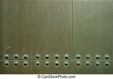 Rivets - Background/industrial image of metal plates with...