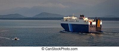 Big Ro-Ro ship and a pilot boat passing near