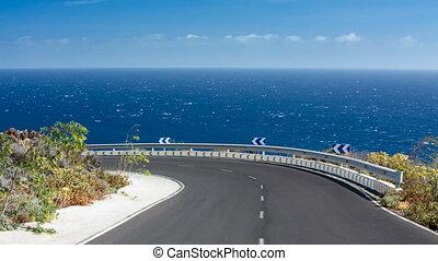 Road Above Sea In La Palma, Spain - View along a road into a...