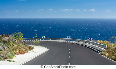 Road Above Sea In La Palma, Spain - View along a road into a...