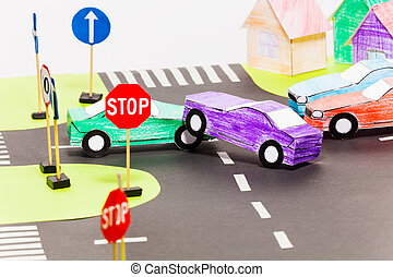 Road accident on a crossings at the toy city