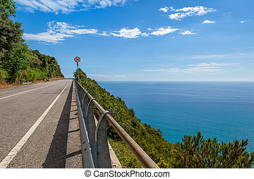 Road along Mediterranean sea coastline in Italy. - Empty...