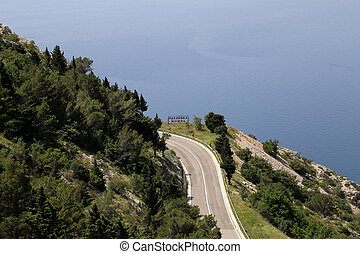 Road along the Adriatic coast in the direction of Makarska Riviera in Croatia