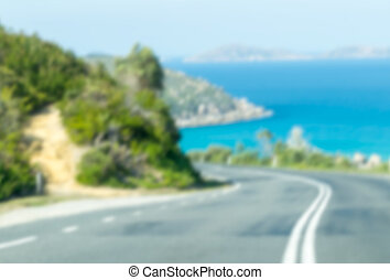 Road along the ocean, blurred view of Australian coast