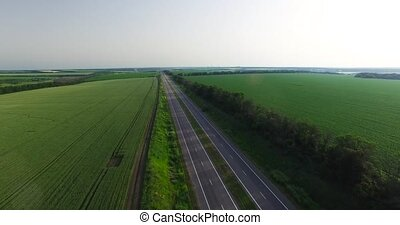 Road among fields, on a summer day. Overhead shot - Road...