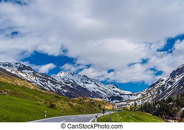 Road amoung snowy Alps mountains, Fluelapass, Davos, Graubuende