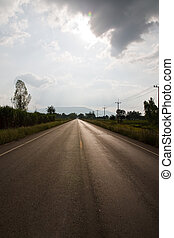 road and blue sky with clouds