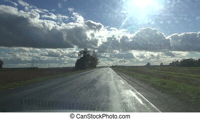road and car window after rain
