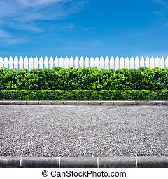 Road and fence - Road side view and white fence on blue sky