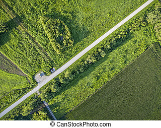 road and green fields aerial view