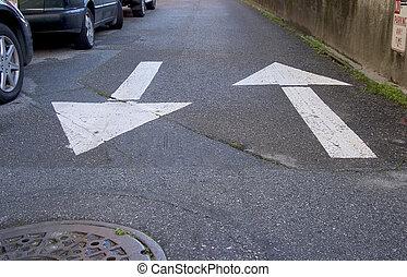 Two way traffic arrows on a street in San Francisco.