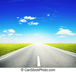 Road - Asphalt road through the green field and clouds on ...