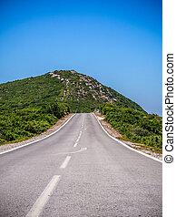 Road at mountain range of Arrabida